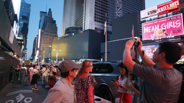 Screens in Times Square are black during a widespread New York power outage.