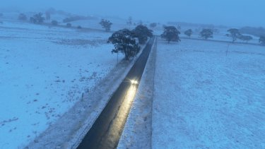 A truck drives through snow in Black Springs in the NSW Central Tablelands on Friday morning.