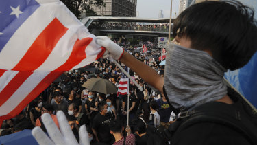 A protester waves a US flag on the streets of Hong Kong.