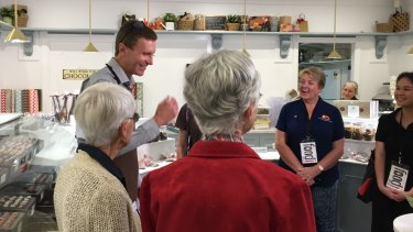 Gerrard Gosens spoke to a food tour group that came to his shop on Tuesday.