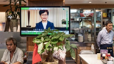 A television replays Hong Kong Chief Executive Carrie Lam announcing the formal withdrawal of the extradition bill inside a restaurant in Hong Kong, China.