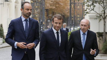 Emmanuel Macron, centre, French Interior Minister Gerard Collomb, right, and Prime Minister Edouard Philippe last year.