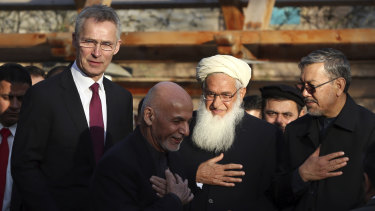 Afghan President Ashraf Ghani (centre) with NATO Secretary General Jens Stoltenberg (left) at the presidential palace in Kabul on February 29, 2020.