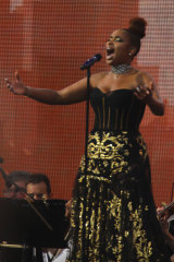 Jennifer Hudson performs with the New York Philharmonic orchestra at We Love NYC.
