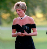 Princess of Wales wearing a black pleated chiffon dress with floating side panel by Christina Stamboulian at a party given at the Serpentine Gallery in London, 1994.