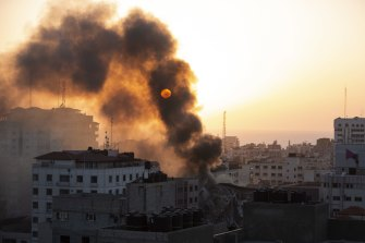 Smoke is seen from a collapsed building after it was hit by Israeli airstrikes on Gaza City on Wednesday.