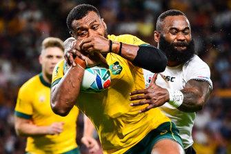 Fiji's Semi Radradra wraps up the Wallabies' Fijian-born centre Samu Kerevi on Saturday.