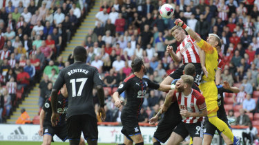 Palace goalkeeper Vicente Guaita punches the ball to keep Sheffield United out at Bramall Lane in Sheffield on Sunday.