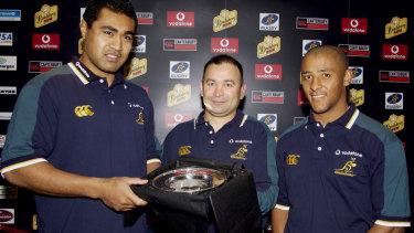 Kefu, left and Jones, with George Gregan in 2001.