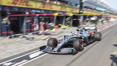 Mercedes' Lewis Hamilton enters pit lane in Melbourne.