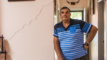 Umberto Galasso at his damaged home in North Strathfield.
