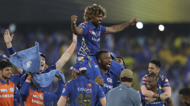 Sneaking home: Lasith Malinga is carried by his teammates after they secured another IPL title.
