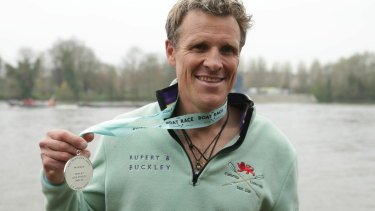 Cambridge's James Cracknell with his boat race medal.