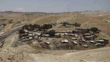 The Bedouin village of Khan Al-Ahmar behind a highway that divides two bustling Israeli settlements in the West Bank last June.