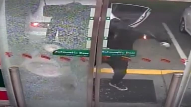 The south-west Brisbane service station being hit by three masked bandits on Friday morning.
