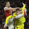 Arsenal's Henrikh Mkhitaryan (left) tangles with Bate's Aleksandr Filipovic.