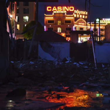 Chinese-funded casinos light up the ruins of an old market in Sihanoukville.