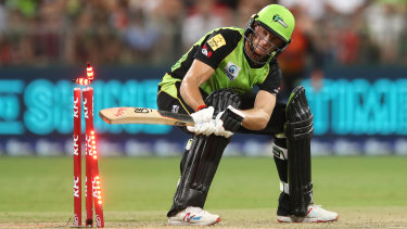 Swept away: Jos Butler is dismissed after hitting his own wicket while batting for Sydney Thunder against Perth Scorchers.