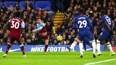 Aaron Cresswell of West Ham United scores against Chelsea at Stamford Bridge.