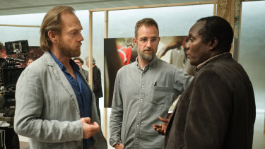 Ben Lawrence (centre) directs Hugo Weaving  and Andrew Luri during the shoot for Hearts and Bones at St Barnabas Anglican Church in Sydney.