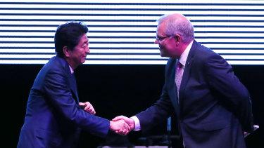 Japanese Prime Minister Shinzo Abe shakes hands with Prime Minister Scott Morrison at the INPEX Gala Dinner.