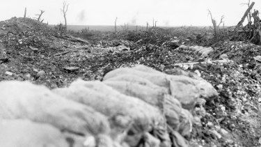Tin-hatted soldiers can be seen in a trench amid the devastation of the Mouquet Farm battlefield.
