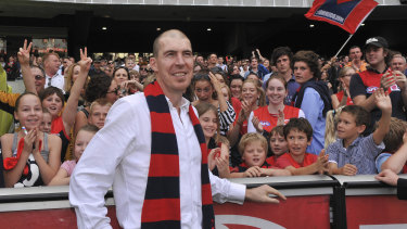 Jim Stynes celebrates a Demons victory with fans in 2010.