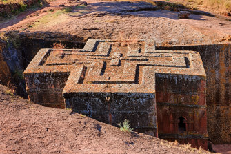 Church of Saint George is the most well known and last built of the eleven churches in the Lalibela area. Bete Giyorgis is carved from solid red volcanic rock in the 12th century.