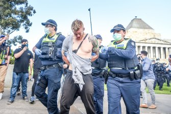 Police making an arrest after a scuffle with protesters at the Shrine of Remembrance on Saturday.
