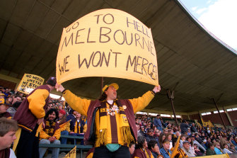 A Hawthorn fan makes his displeasure known about the proposed merger.