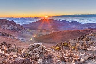 The sun rises over the summit of Hawaii's Haleakala volcano.