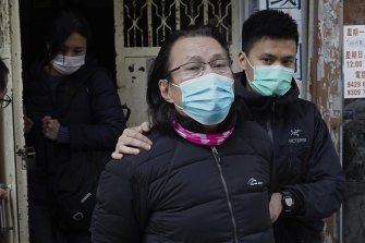 District councillor and lawyer Daniel Wong Kwok-tung, (centre), is escorted by police outside his office after police search in Hong Kong, on Thursday, January 14.