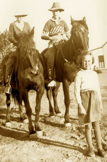 Jill Ker Conway, foreground, as a child with father, Barry, right on horse, and brother Bob, left.