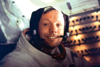 """Neil Armstrong is seen smiling at the camera aboard the lunar module """"Eagle""""."""