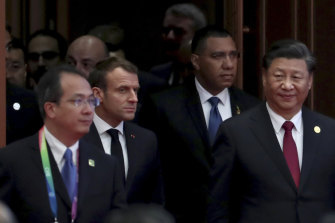 Macron, second from left, and Xi, right, were addressing the audience at a Chinese trade expo in Shanghai attended by representatives of 63 countries.