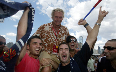A-League Grand Final between Melbourne Victory vs Adelaide United - SBS commentator Damien Lovelock with soccer fans at the Telstradome, 2007.