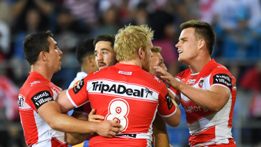 More responsibility: Ben Hunt celebrates with teammates after scoring against the Gold Coast.