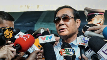 Thailand's PM Prayut Chan-o-cha addresses the waiting media after casting his vote on Sunday.