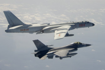 A Taiwanese Air Force F-16 in foreground flies on the flank of a Chinese People's Liberation Army Air Force H-6 bomber in 2020.