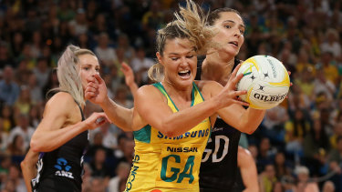 Gretel Tippett under pressure from Karin Burger in Australia's series-deciding win over New Zealand.