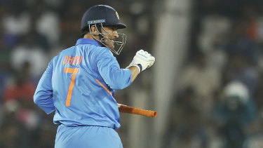 Ageless: MS Dhoni continues to thwart the Australians, who know they need to find a way to get him out cheaply.