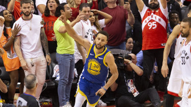 Not yet: Steph Curry celebrates after Kyle Lowry's last-second miss.