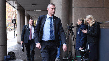 AFP officers arrive at the ABC offices, where they spent the afternoon sifting through thousands of documents related to an ABC investigation.