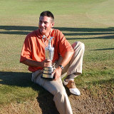 Ben Curtis celebrates with the coveted Open trophy in 2003.
