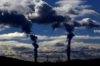 A price on carbon means companies pay for emitting greenhouse gases.