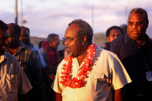 Sir Michael Somare, leader of the National Alliance at Port Moresby domestic airport in 2015.
