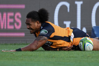 Brumbies winger Solomone Kata slides in for a try against the Chiefs.