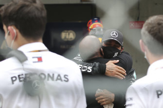 Lewis Hamilton embraces his father, Anthony Hamilton, after the Portuguese Grand Prix.