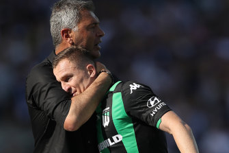 Mark Rudan hugs Besart Berisha after the striker was substituted off against Victory.