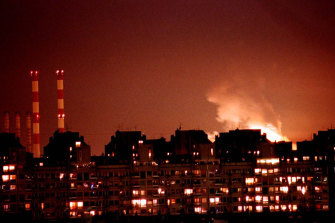 Flames from an explosion light up the Belgrade skyline near a power station after NATO cruise missiles and warplanes attacked Yugoslavia.